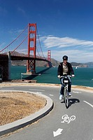 Cyclist, Golden Gate Bridge at the back, San Francisco, California, USA