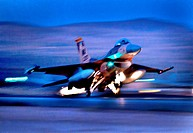 An F-16 Fighting Falcon aircraft takes off for a night mission at Nellis Air Force Base, Nev , Oct  30, 2012  The aircraft is assigned to the Weapons ...