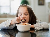 USA, Utah, Alpine, portrait of girl 8_9 eating breakfast