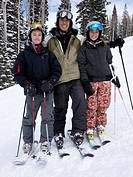 Portrait of father and daughter skiing
