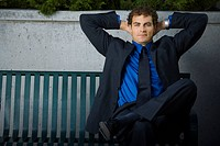 Businessman sitting on a bench