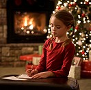 girl writing a letter to santa claus
