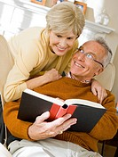 Mature man with book and mature woman