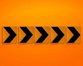 Orange direction sign