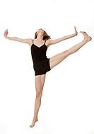 Studio shot of young woman dancing