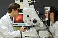 Eye examination  Doctor using a retinal camera during an angiography examination of a patient´s eye  Coloured chemicals have been injected into the pa...