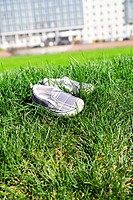Children´s footwear on a green grass
