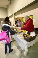 Brick, New Jersey - Volunteers with Operation Brick Food Relief serve meals to people displaced by Hurricane Sandy
