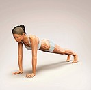 Skeleton layered over a female body in plank pose showing the skeletal alignment of this particular yoga posture.