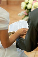 Couple reading together Bible during Christian wedding ceremony, Firenze, Tuscany, Italy