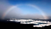 Rainbow over sea_ice Northwest Passage, Nunavut, Canada
