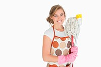 Portrait of smiling woman with cleaning supplies