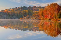 Simon Lake with morning fog and autumn reflections, Greater Sudbury Naughton, Ontario, Canada