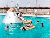 Prime crew for the first manned Apollo mission practice water egress procedures with full scale boilerplate model of their spacecraft. Astronaut Edwar...