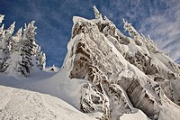 A male skier sprays a powder turn in the Revelstoke Mountain Resort Backcountry, Revelstoke, BC