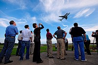 Media and some space shuttle flight directors view the 747 Shuttle Carrier Aircraft with Atlantis on top as it returns to the Kennedy Space Center aft...