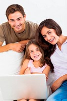 Happy family using the laptop