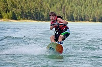 Young boy wakeboarding on Lake Koocanusa, East Kootenays, BC, Canada