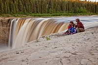 Young family enjoys view at Alexandra Falls, Northwest Territories, Canada