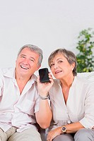 Old lovers listening to a smartphone