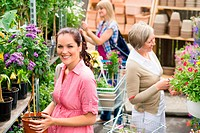 Woman hold potted plant at garden shop