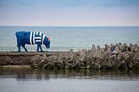 Sculpture Sailor Cow on the Southern breakwater of harbor is part of the Ventspils CowParade art project, Ventspils, Latvia, Baltic States, Europe