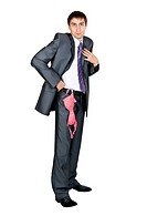 businessman in a gray suit from his pocket a pink bra hanging