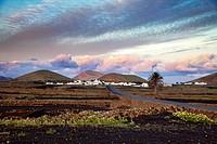 Village Mancha Blanca, Timanfaya National Park in the background, Lanzarote, Canary Islands, Spain, Europe