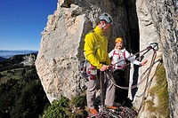 Young man belaying young woman, Kampenwand, Chiemgau Alps, Chiemgau, Upper Bavaria, Bavaria, Germany