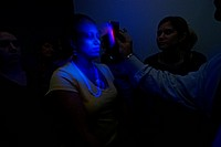 Nursing students at Emory University in Atlanta, Georgia use ultraviolet light to look for biological agents as part of biohazard training. In the eve...