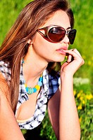 pensive girl wearing sunglasses