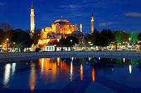 Lights on Hagia Sophia at twilight with reflections in fountain Istanbul Turkey
