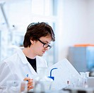 young male researcher carrying out scientific experiments in a lab