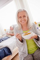 Senior woman eating cereal from bowl