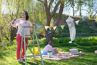 Woman hanging bunting outdoors