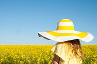 Girl wearing sun hat outdoors