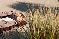 Women napping on beach