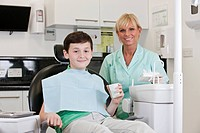 A young boy at the dentist with a dental nurse/hygienist