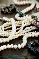 Necklaces of natural black and white pearls