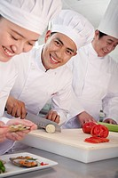 Chinese chefs in commercial kitchen