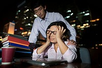 Chinese business people working at desk at night