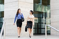 Hispanic businesswomen walking together