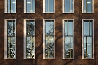 5 Hanover Square, London, United Kingdom. Architect: Squire and Partners, 2012. Detail of brick facade with window reveals and vertical bronze fins.