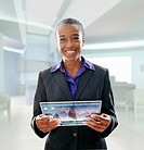 Black businesswoman using digital tablet in office