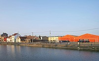 Zap´ Ados Skatepark, Calais, France. Architect: Bang Architectes, 2011. Panoramic view across canal to former industrial district.