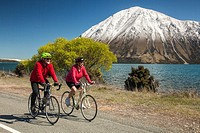 Cyclists enjoys spring conditions on back roads Lake Ohau, Mackenzie country, Canterbury, New Zealand not for sale to cycle industry