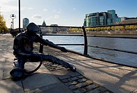 Sculpture Of A Docker With The Ifsc And Custom House On The Far Bank, Across The River Liffey, Dublin City, County Dublin, Ireland