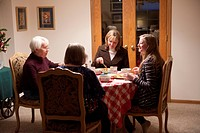 A family gathers together for dinner at a home in Elkhorn, NE.