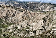 Calanchi del Cannizzola, a geological formation known as Badlands where softer sedimentary rocks and clay soils have been eroded by wind and water nea...