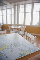 Table With Map Surface Inside The Royal Lake Of The Woods Yacht Club, Kenora Ontario Canada